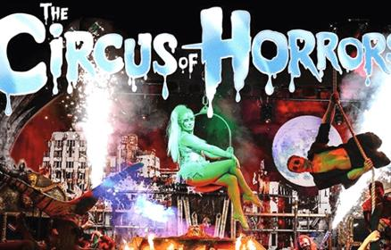 Circus of Horrors featuring cast members performing acts.