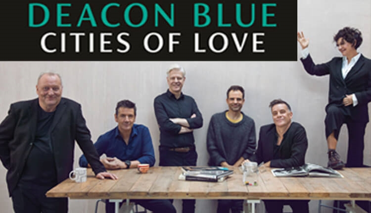 Deacon blue sitting at a table
