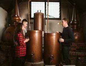 A couple enjoying a tour of whiskey making process at Killowen Distillery.