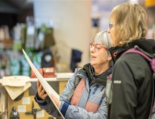 Walkers reading some maps at Saint Patrick Centre gift shop, Downpatrick
