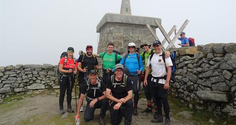 Group of walkers with Peter from Walk the Mournes at the top of Slieve Donard Mountain © Walk the Mournes