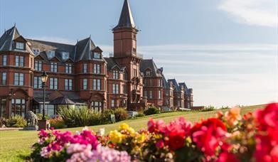 Slieve Donard hotel and ground with sun shining