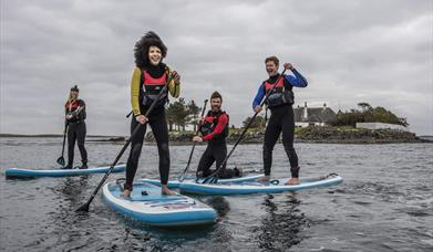 Group enjoys Stand Up Paddleboarding in Strangford Lough