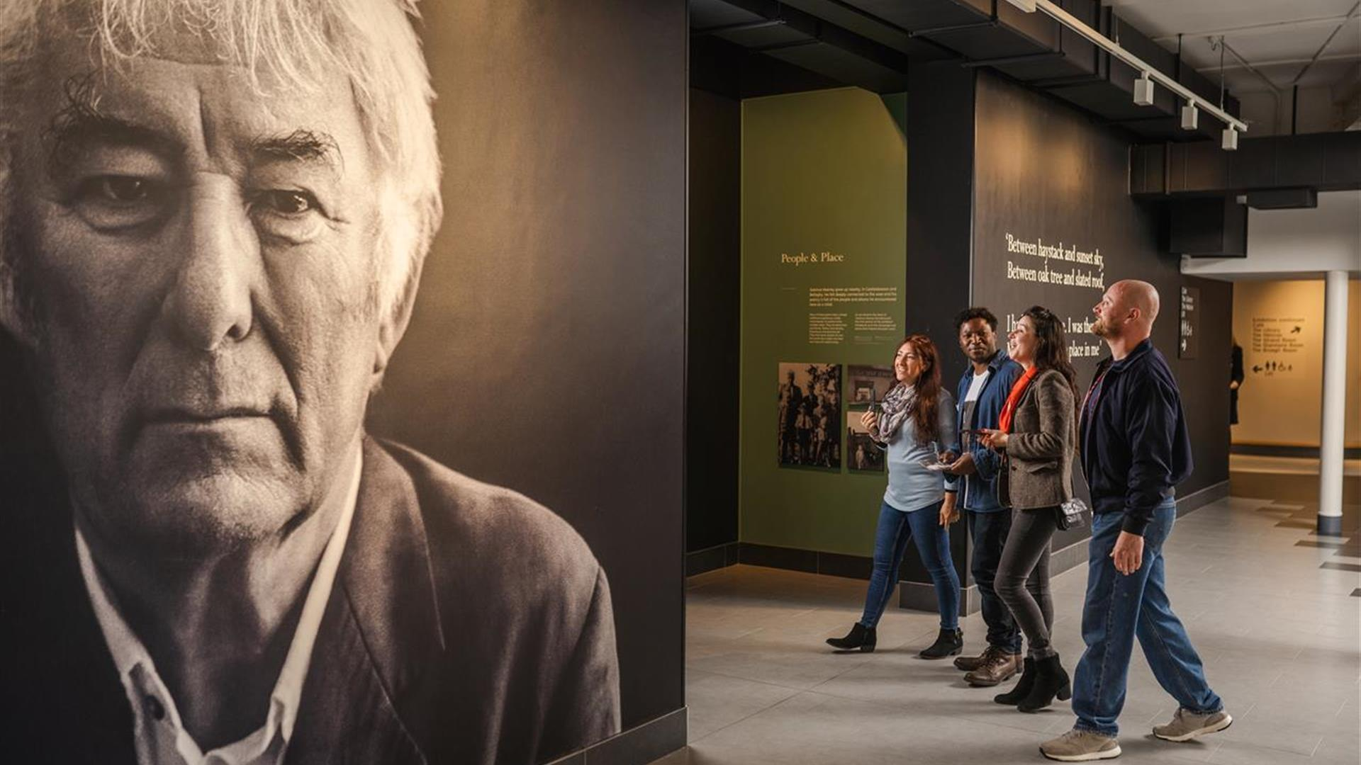 Group of friends walking through the Heaney Experience