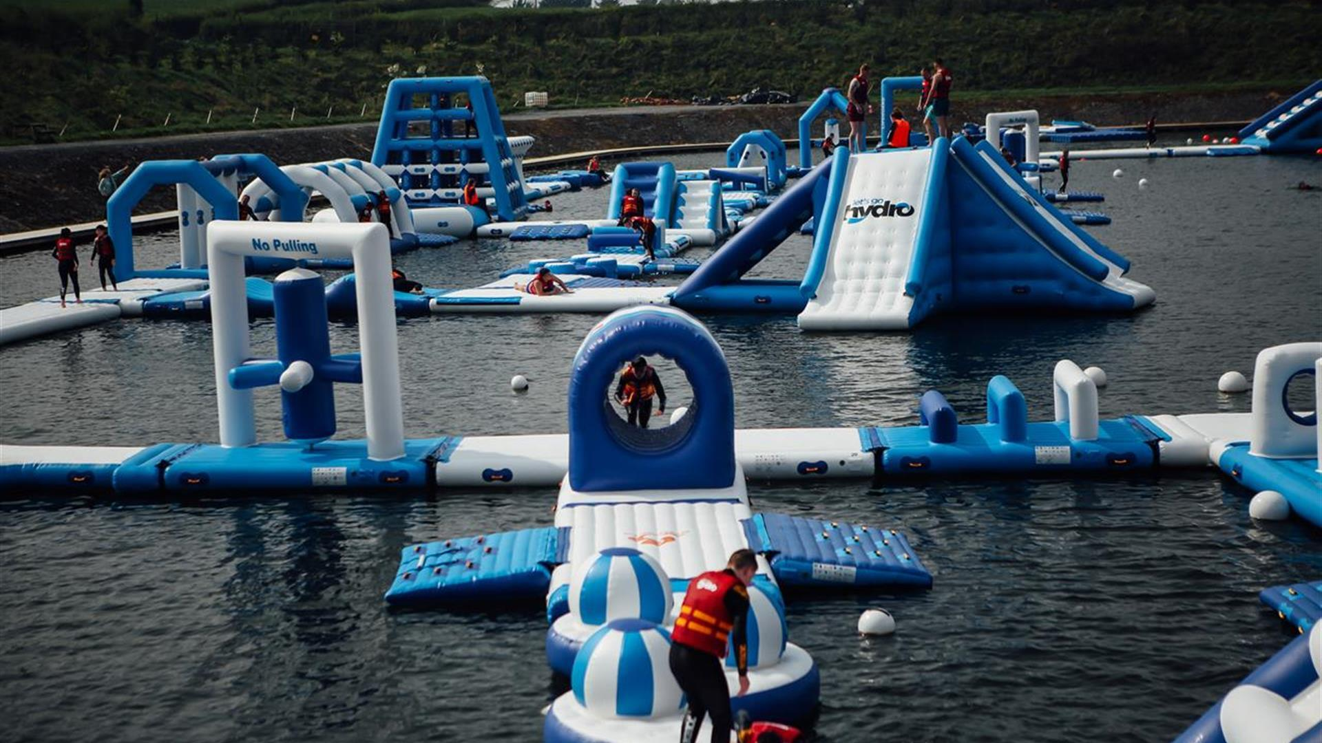 Image shows inflatables on the lake at Let's Go Hydro