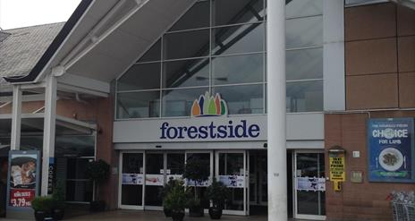Image shows entrance to the shopping centre with signage