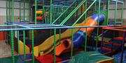 Indoor soft play area with slides