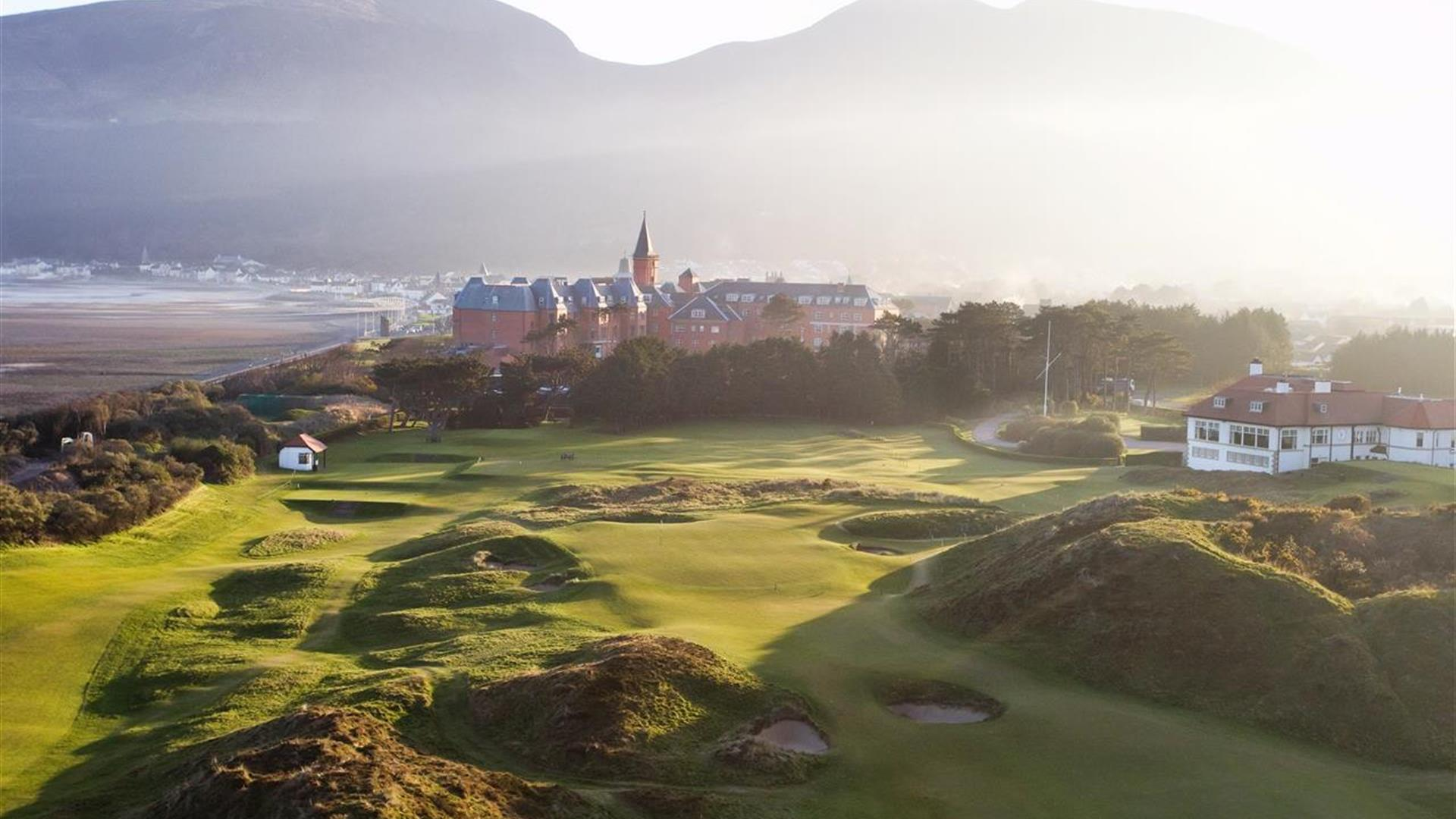 Image showing Royal County Down Golf Course and Slieve Donard Resort and Spa, with Slieve Donard mountain in the background.