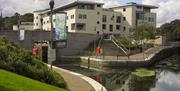 Image shows the Civic Centre with walking path around the Lagan lock