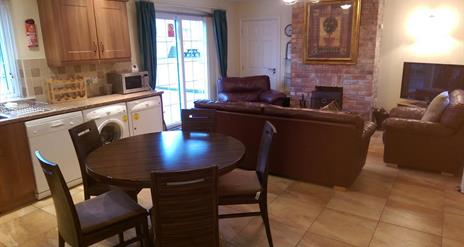 Image shows image of kitchen, diner and lounge space
