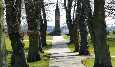 Tree lined avenue in Castle Gardens leading up to memorial