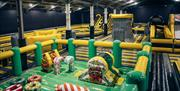 Image shows various inflatables in the main area of We Are Vertigo