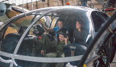 Family in cock pit of helicopter