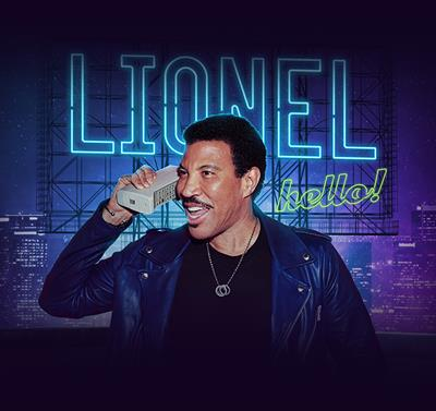 """Official Lionel Richie concert artwork, consisting of Lionel using a retro phone in front of a neon sign that says """"LIONEL hello!"""""""