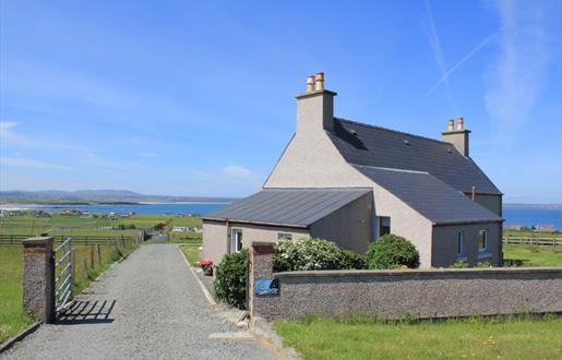 MAIN VIEW OF HOUSE FROM ROADWAY SHOWING BROADBAY IN DISTANCE
