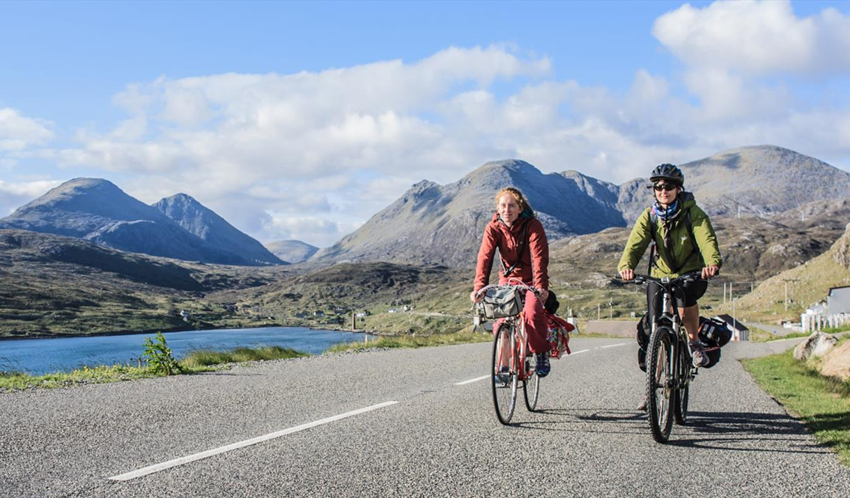 Harris: cyclists at Ardhasaig with Clisham backdrop