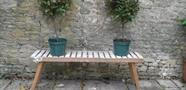 Slatted plant stand in the courtyard of Cotswold Home and Garden in Chipping Norton