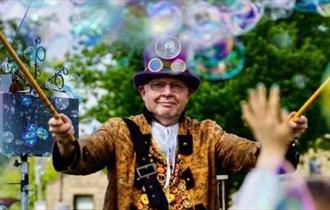 The Big Bubbleman, his bubble mill, wands and special potions make the most AMAZING bubbles!