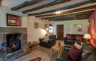 the sitting room with oak beams