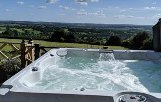 Relax in the hot tub complete with a fabulous view!