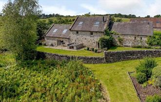 A stunning Grade II listed, detached stone barn conversion awaits you at Waterside Barn