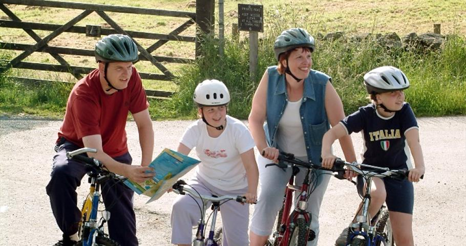 Picture of a family cycling in Pendle