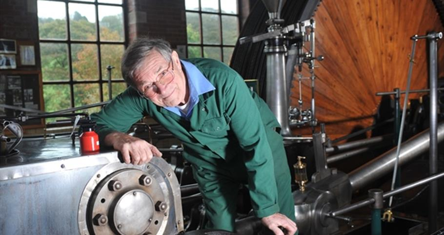 Picture of Harry and flywheel at Bancroft Mill