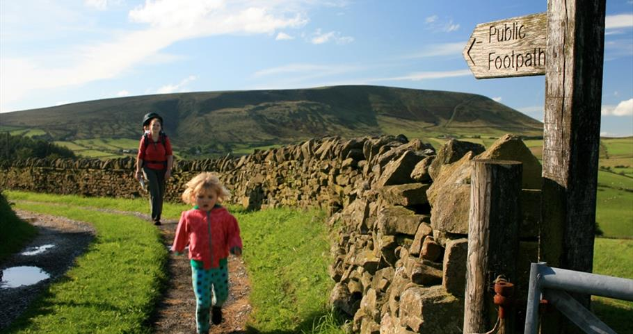 Picture of a family walking near Pendle Hill
