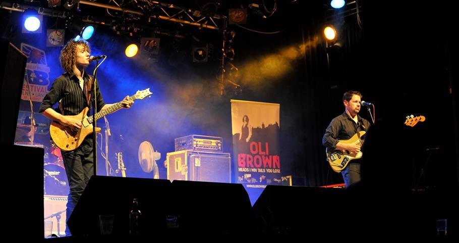 Picture of Oli Brown playing guitar at the Blues Festival