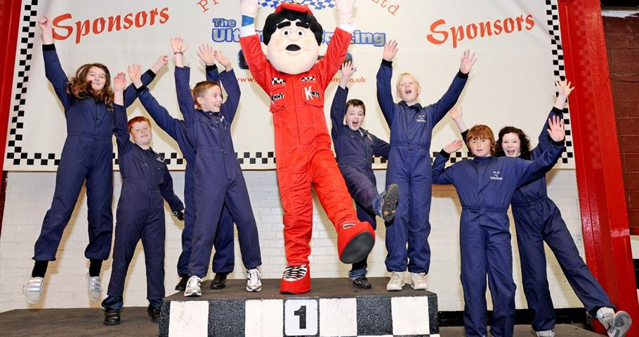 Picture of children celebrating on the winners podium Prestige Karting Pendle