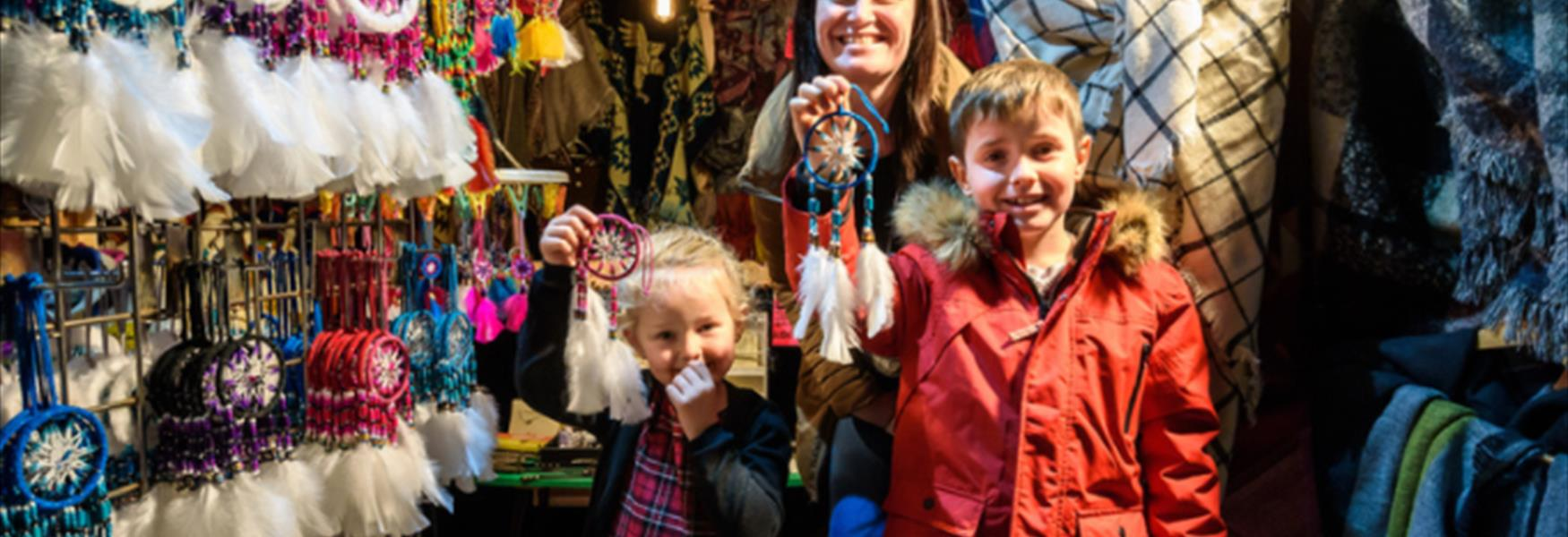 Children holding up some crafts at the Peterborough Christmas Market