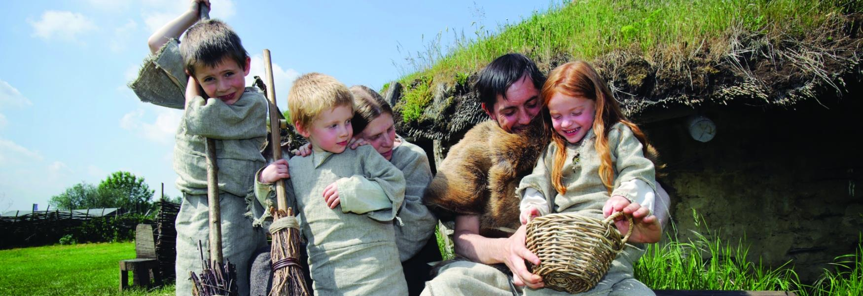 A family dressed up with Bronze Age costumes.