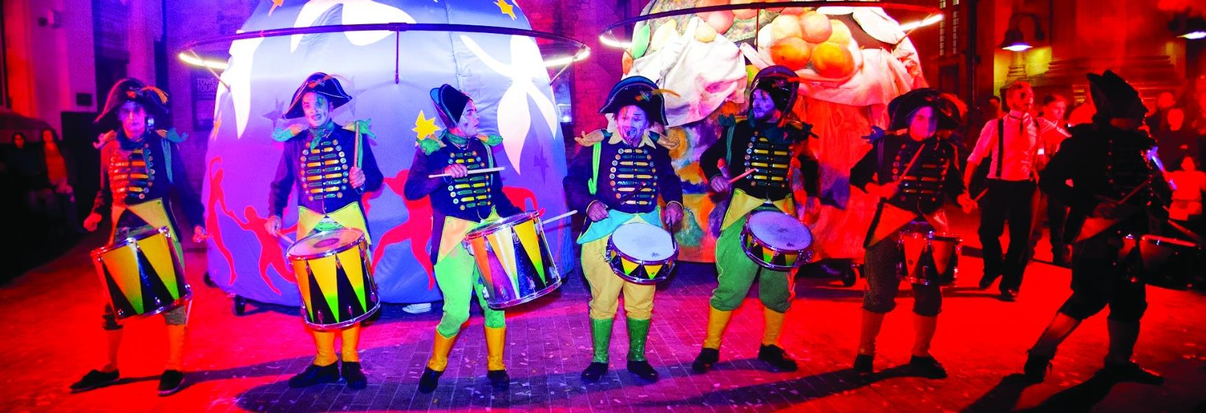 Image of a group of drummers dressed in costumes.