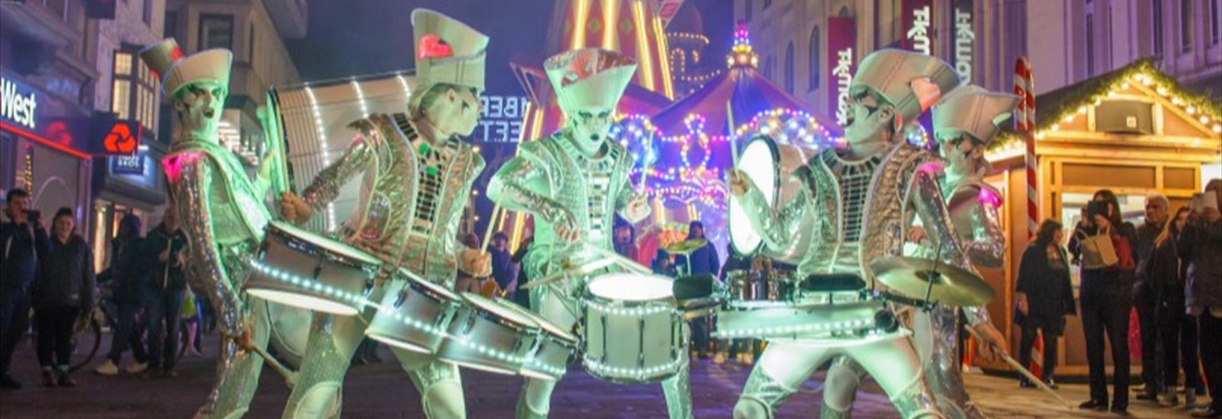 Spark! is a street theatre show that combines high-impact drumming with kaleidoscopic lighting design
