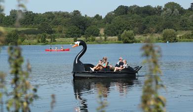 A family enjoys a pedalo ride in Ferry Meadows