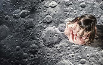 Small girl walks on moon