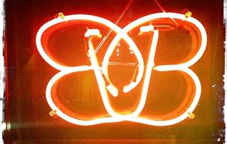 Brightly lit neon sign of the B-bar