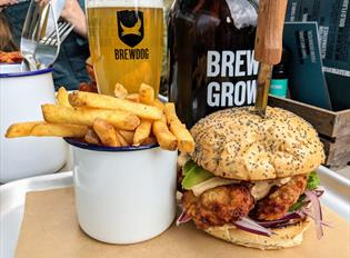 Cup of fries, burger and pint of BrewDog