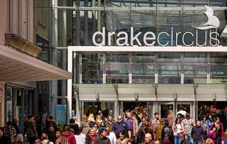 The entrance to Drake Circus shopping mall busy with shoppers.
