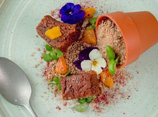 A sumptuous dessert creation at the Box Kitchen & Bar including edible flowers.