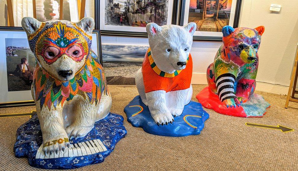 Dressed up polar bear statues