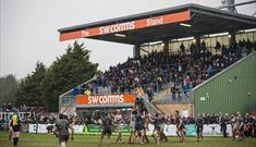 View of Plymouth Albion playing Rugby with spectators watching.
