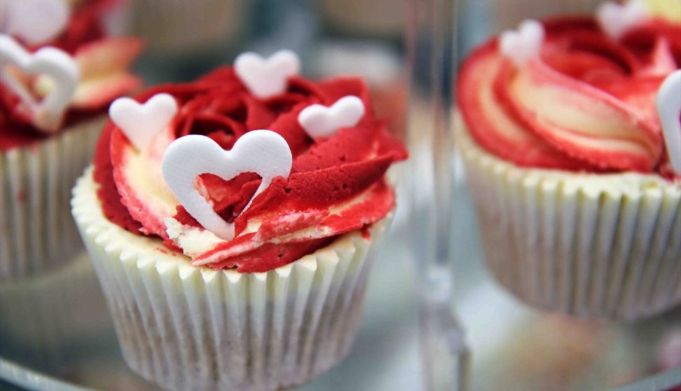 Romantic cupcake with red icing and love hearts at the Studio Lounge