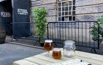 Outside seating outside Steel Brew Co