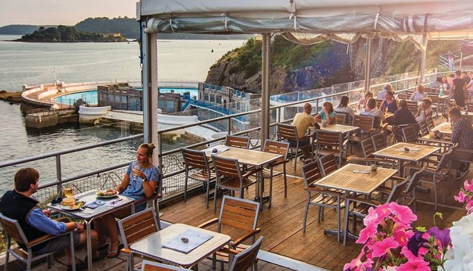 The Terrace's under cover outside seating area with customers eating and drinking. Beautiful views of Drake's Island and Tinside Lido.