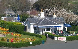 Valenti's and adjacent gardens shown from Plymouth Hoe with people sat outside