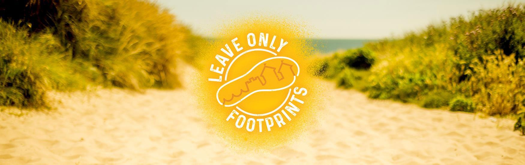 Leave only footprints logo with stunning beach in background