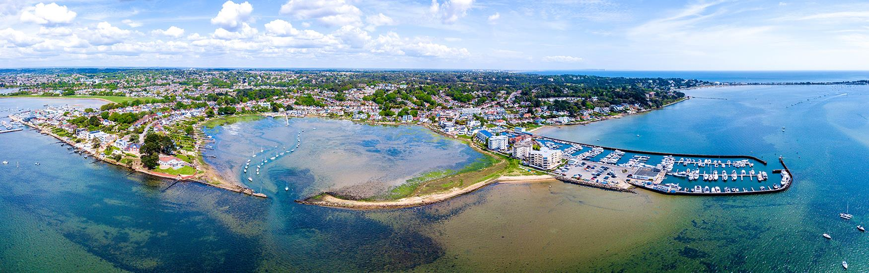 Aerial view of Poole harbour and marina with the blue hue of the sea enhancing the image