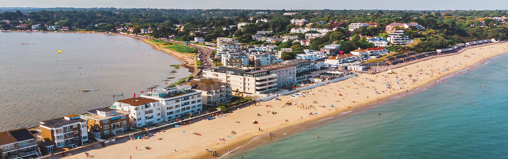 Amazing birds eye shot of an area of Sandbanks beach with visitors lapping up the sun and sea on a lovely sunny day