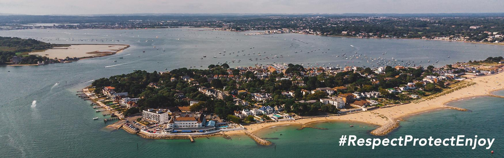 A shot of Poole Bay and Brownsea Island with Respect Protect and Enjoy messaging overlaying it